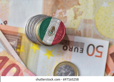 euro coin with national flag of mexico on the euro money banknotes background. finance concept