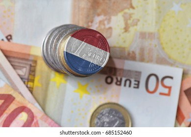 euro coin with national flag of netherlands on the euro money banknotes background. finance concept