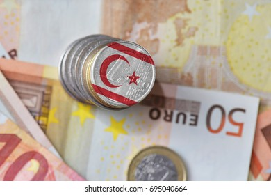 euro coin with national flag of northern cyprus on the euro money banknotes background. finance concept