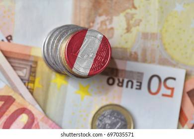 euro coin with national flag of peru on the euro money banknotes background. finance concept