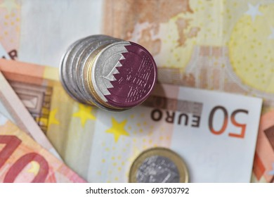 euro coin with national flag of qatar on the euro money banknotes background. finance concept