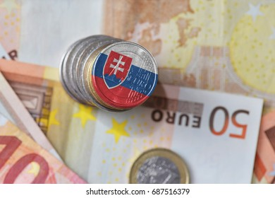 euro coin with national flag of slovakia on the euro money banknotes background. finance concept