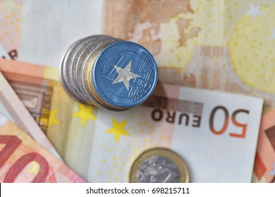 euro coin with national flag of somalia on the euro money banknotes background. finance concept