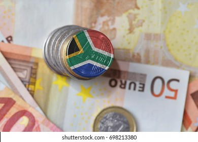 euro coin with national flag of south africa on the euro money banknotes background. finance concept