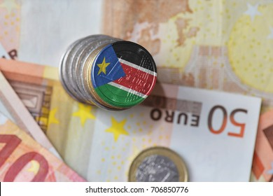 euro coin with national flag of south sudan on the euro money banknotes background. finance concept