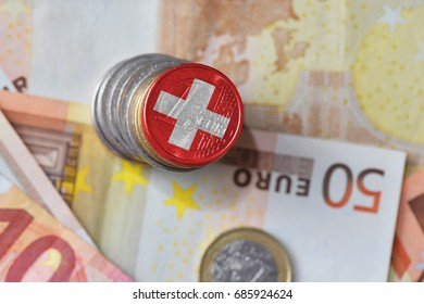 euro coin with national flag of switzerland on the euro money banknotes background. finance concept