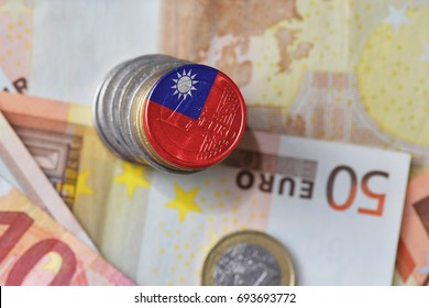 euro coin with national flag of taiwan on the euro money banknotes background. finance concept