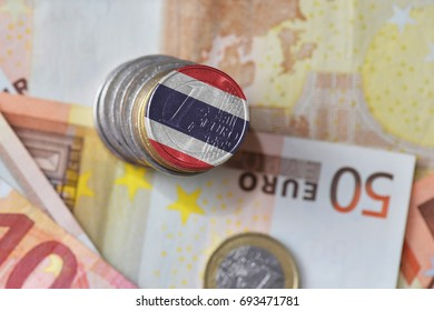euro coin with national flag of thailand on the euro money banknotes background. finance concept