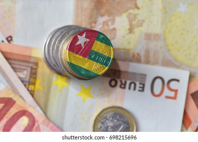 euro coin with national flag of togo on the euro money banknotes background. finance concept