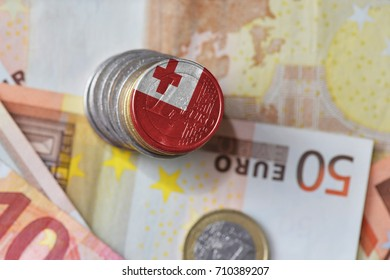 euro coin with national flag of Tonga on the euro money banknotes background. finance concept