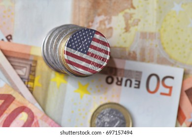 euro coin with national flag of united states of america on the euro money banknotes background. finance concept