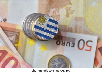 euro coin with national flag of uruguay on the euro money banknotes background. finance concept