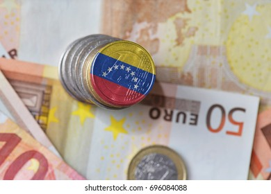 euro coin with national flag of venezuela on the euro money banknotes background. finance concept