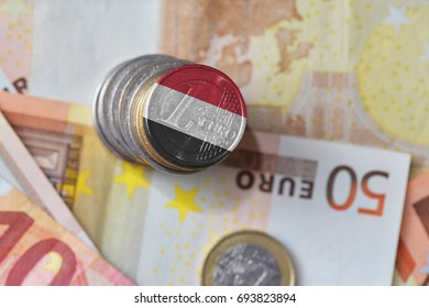 euro coin with national flag of yemen on the euro money banknotes background. finance concept