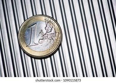 Euro coin on a metal surface.
