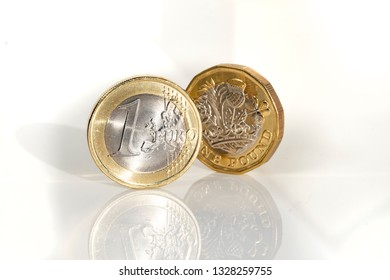 Euro coin and pound coin, the basic currency units of the EU and the UK, picture shows reflection of coins
