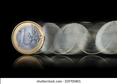 euro coin spin on dark background