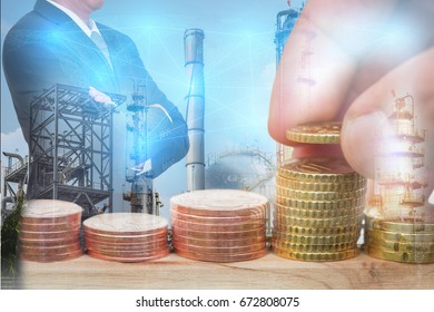 Euro Coin stacks, businessman arms crossed, glowing blue world map and oil, fuel, electric generating factory as business, investment,exchange rate, saving, technology, industrial and energy concept.