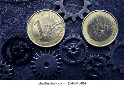 Euro coins and assorted gears - EU economy concept