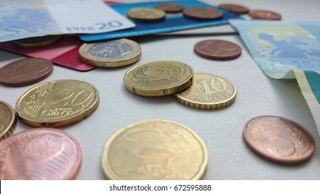 Euro coins, bank notes and credit cards. Thirty cents.