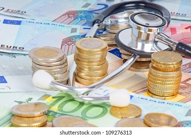 euro coins with banknotes and stethoscope