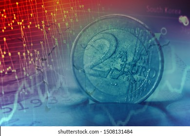 Euro coins and business data. Selective focus.