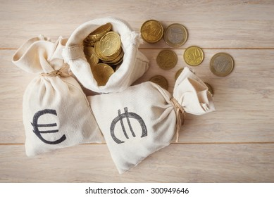 Euro coins in money bags, top view