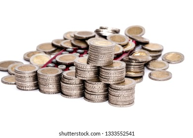 Euro coins money stack and single coins scattered over a pocket calculator