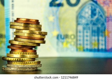 Euro coins on euro banknotes as background. Close-up of several euro coins. Concept of trading on the stock exchange. Euro exchange rate