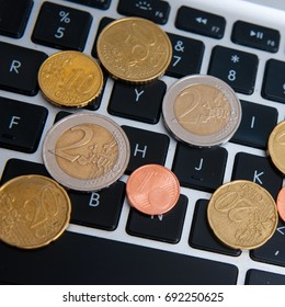 Euro coins on the keyboard.