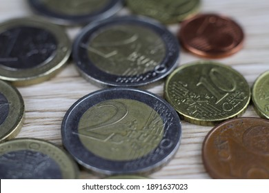Euro coins on a wooden background