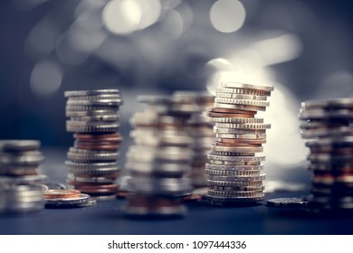 Euro coins with shallow depth of field. European currency close up. Banking, economics, saving money.