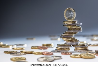 Euro coins stacked on each other in different positions. Close-up european money and currency.