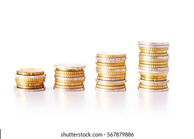 Euro coins. Stacks isolated over white background.