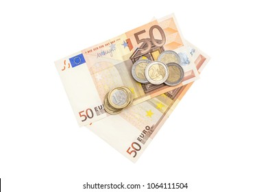 Euro coins with two 50 euro bills on white background. Top view.
