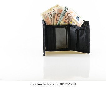Euro currency cash inside a black wallet. White and grey gradient background and a soft shadow of the wallet are visible.
