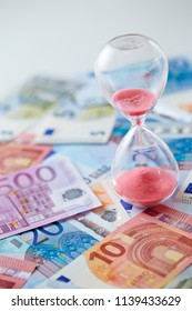Euro currency with hour glass