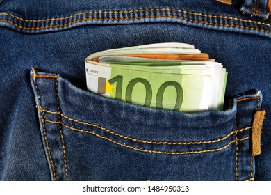 Euro currency money cash, euro banknotes in the pockets of jeans trousers. Concept of wealth, saving or spending money. Euro bills falling out. Easy to steal the money.