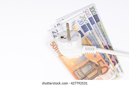 Euro currency and plug. Concept of saving electricity at home.
