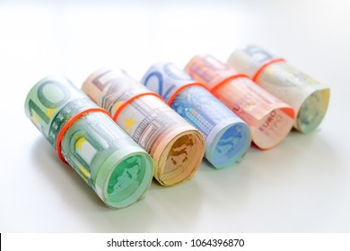 Euro Currency, Rolled banknote on white background.