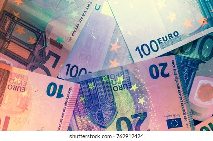 Euro currency in UV light inspection, toned