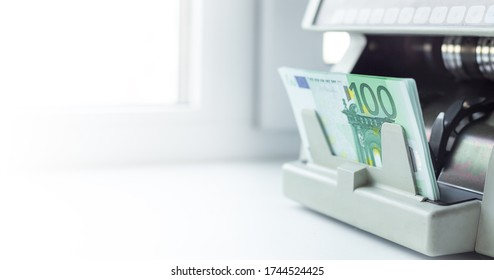 Euro EUR banknotes of 100 on money counter machine. Automatic money counting in the machine - Image