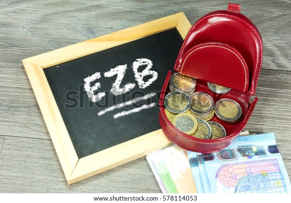 Euro Geld, wallet and a chalkboard with the German abbreviation for the European Central Bank