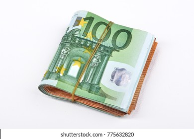 Euro money bank. Rolled up Euro bills on white background. One hundred and 50 Euro bills