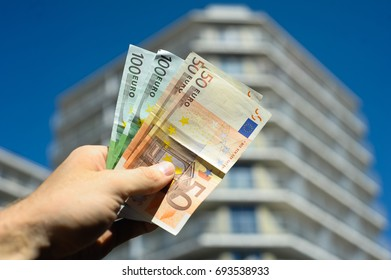 Euro money and building with flats