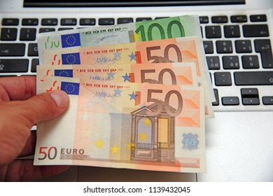 euro money and computer keyboard - economic transaction and bank on line
