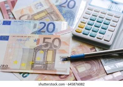 Euro money currency with pen and calculator for economy plan concept.