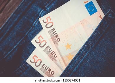 euro money in a denim pocket