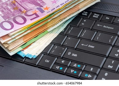 euro money with laptop on the table