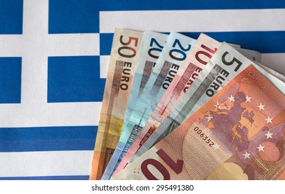 Euro money on the background of the Greece flag.
